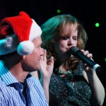 Debbie singing Santa Baby to audience participant